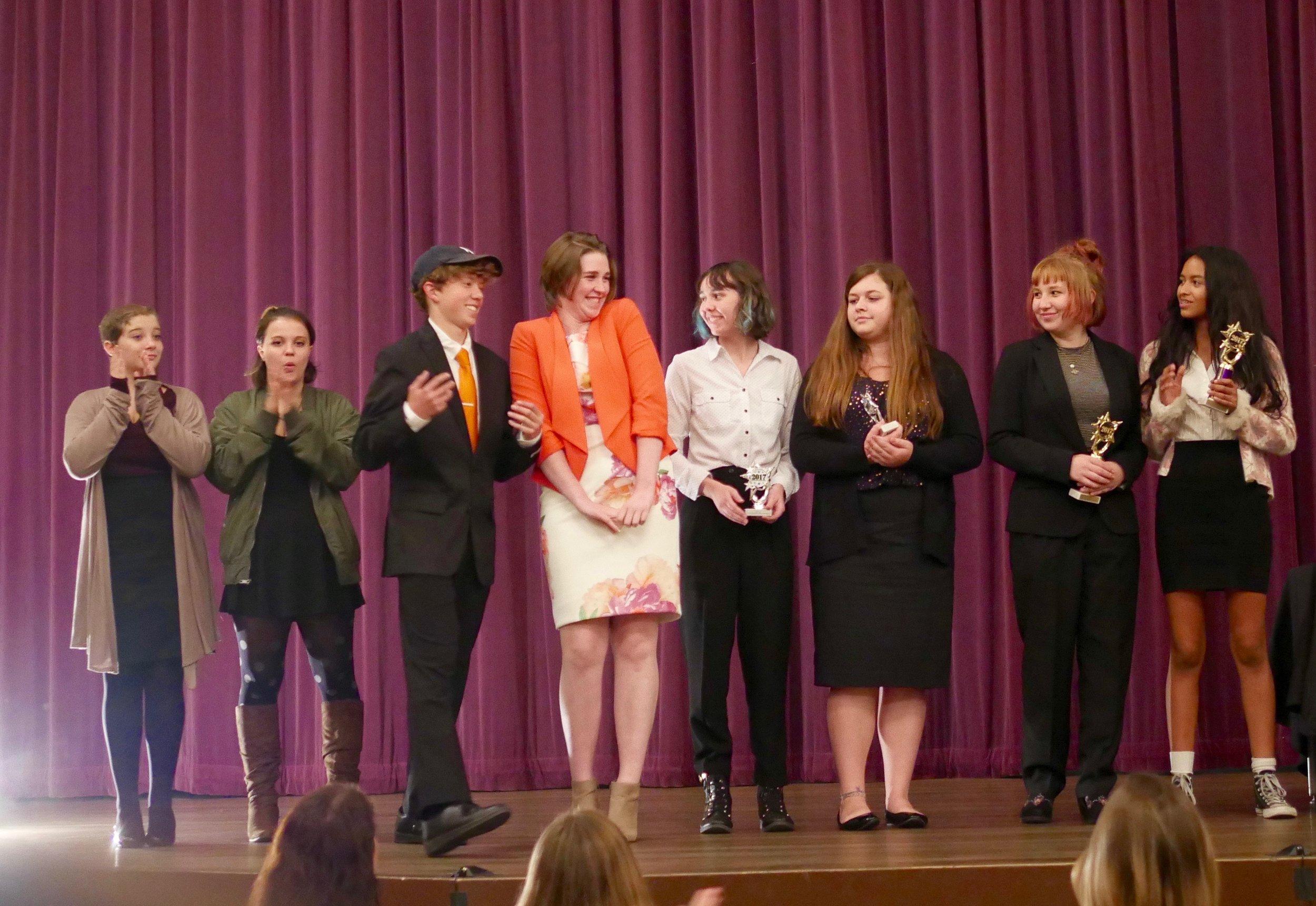 (from left) Kylah Ward, Jade Loev, Grant Lulich, Gabi Taylor, Hailey Carroll, Amelia Kahn, Claire Glassford, and Jasmine Yanez receive novice parli awards