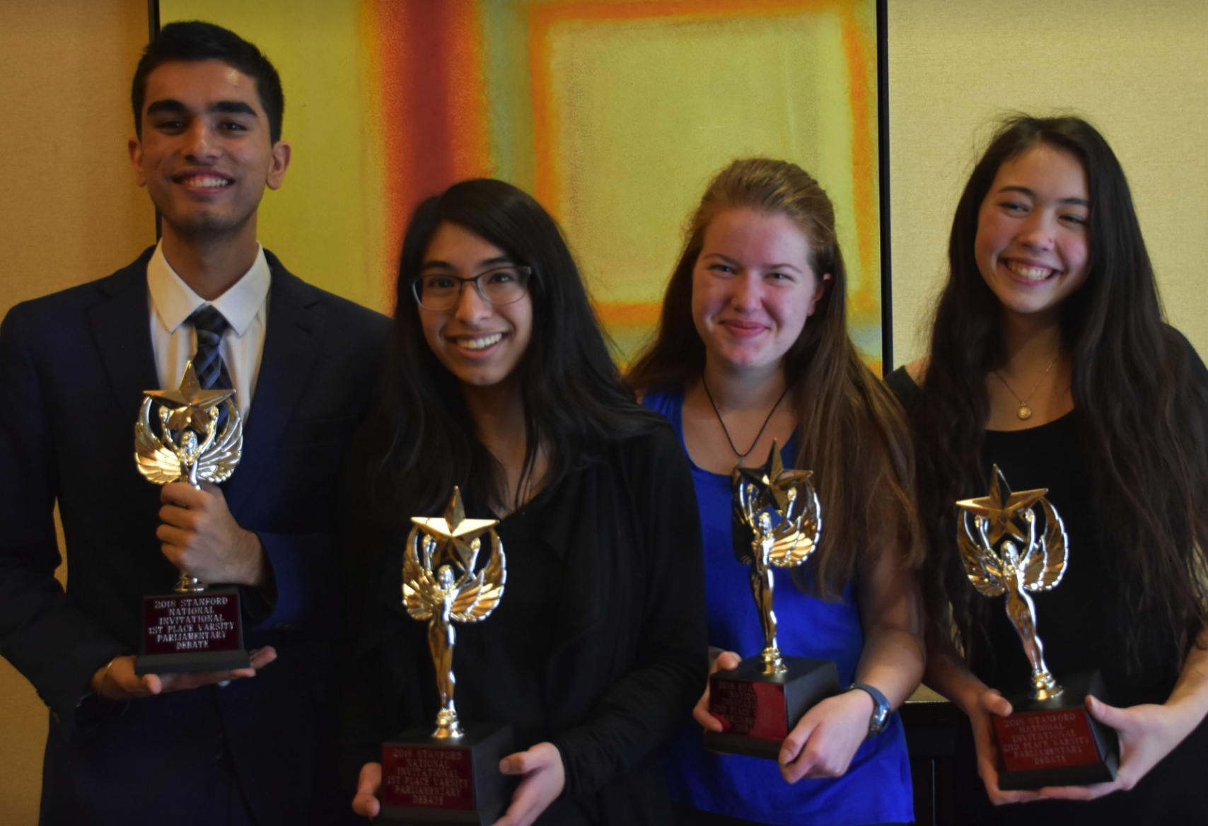 (left to right) Pombra, Bhattacharya, Aaronson, & Larson pose with awards after the final round