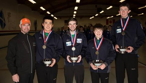 Evan McCauley (center) and his team after winning the Curling Junior National Championships in Seattle earlier this year.  source