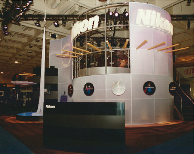 Nikon Precision  Two-level trade show booth design, performance space and graphics