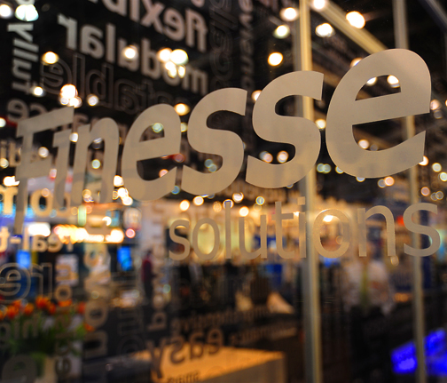 "Finesse Solutions  Type graphics on ""clean room"" trade show booth"
