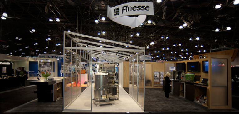 "Finesse Solutions  ""Clean Room"" trade show booth, ""F"" reception desk and product presentations"