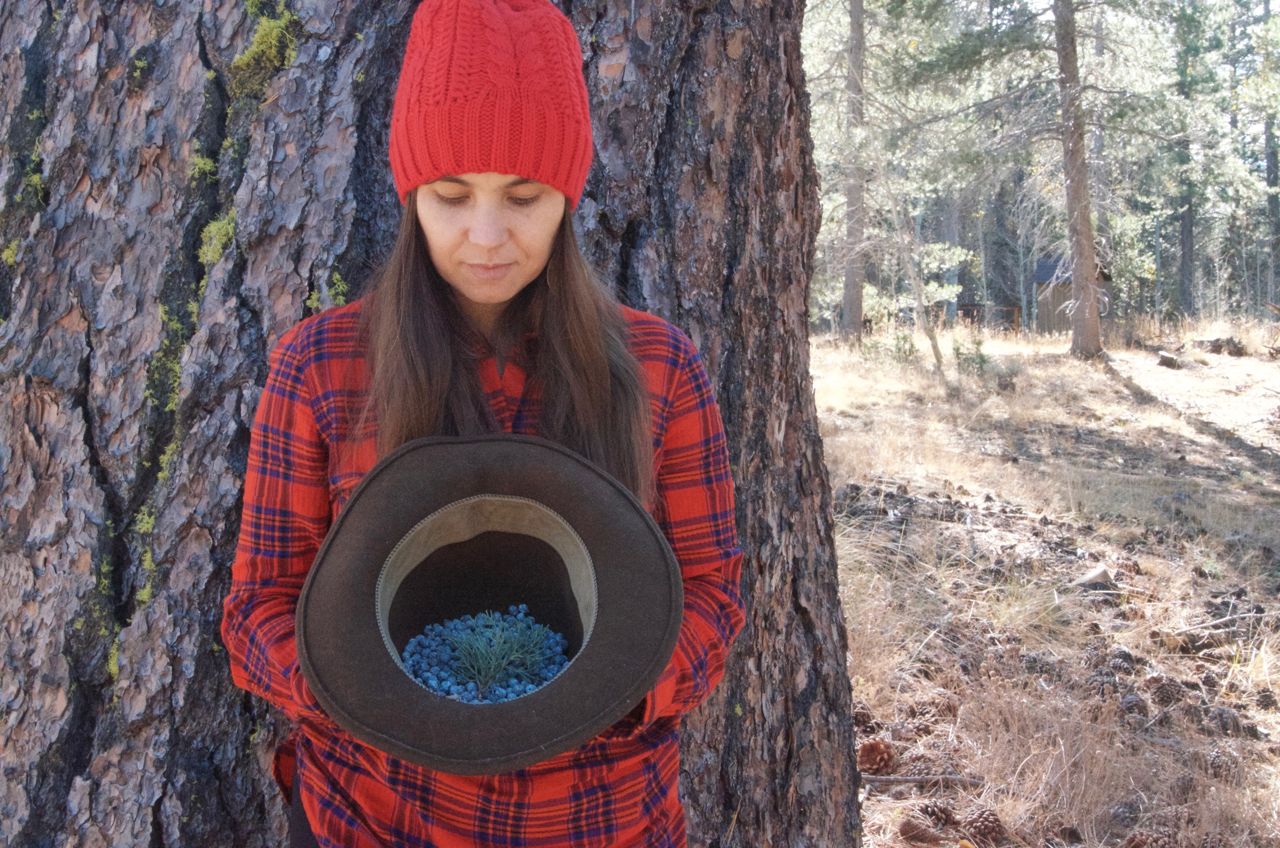 Amber of Aquarian Dawn with some lovely Juniper berries we harvested in her bio-region, or more precisely her home town, her sister's backyard. <3