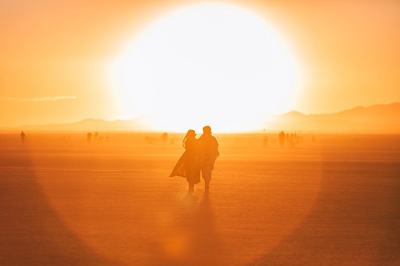 burning man sunrise over the playa