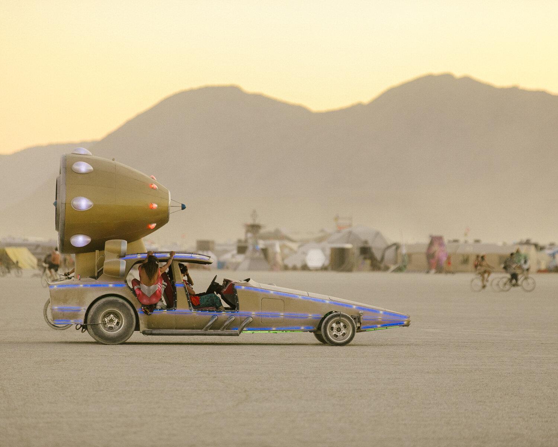 art cars on the playa at burning man