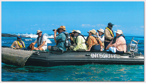 Linda Cayot and Richard Polatty leading Galapagos Conservancy guests aboard Integrity