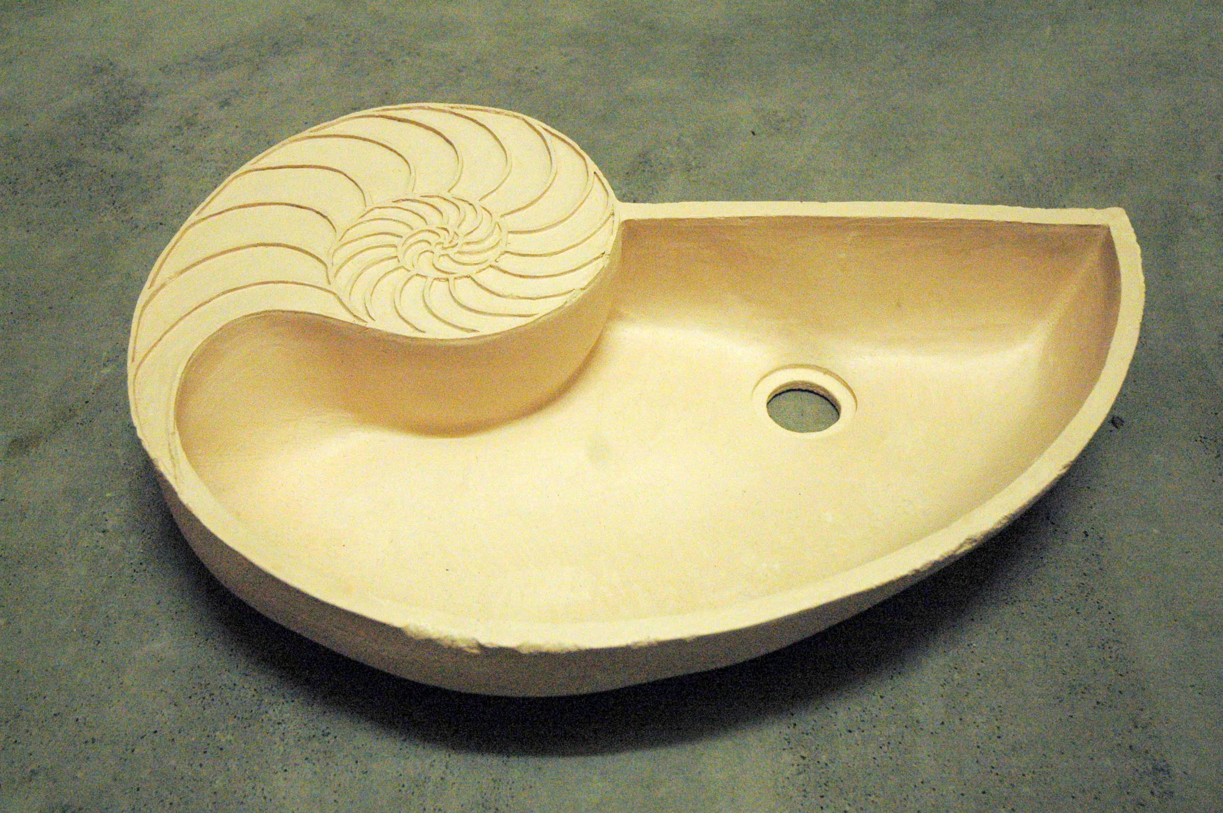 This basin is currently at the bisque stage of production, ready to glaze as desired.