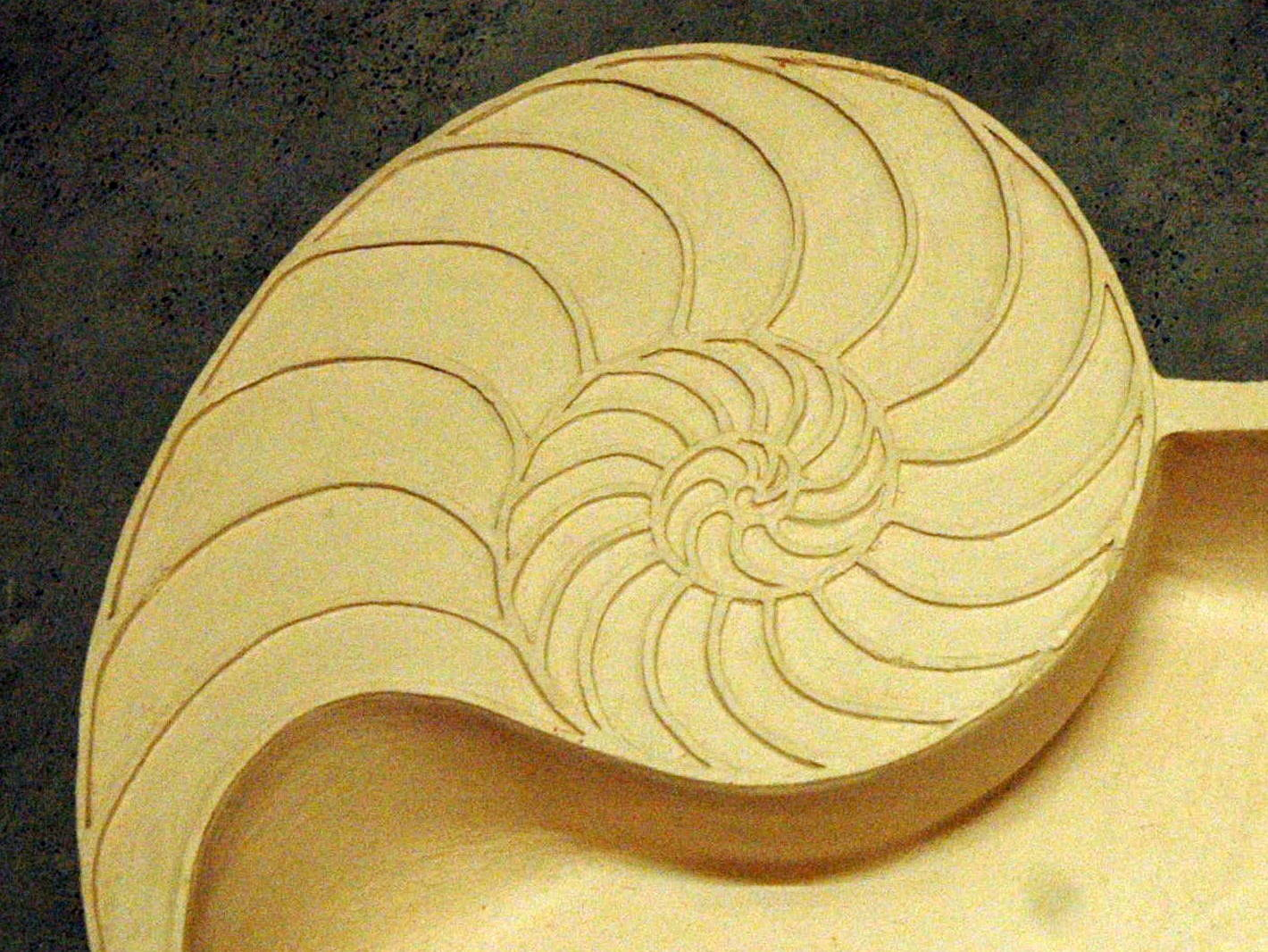 New Nautilus Basin, still showing the beauty of the spirals but with a design that is easier to clean and maintain.