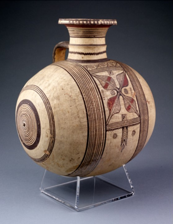 Jar with geometric designs, Cyprus, perhaps Kourion, about 750-600 BC.  Unglazed earthenware, made in sections and assembled, covered with buff slip and painted.  Museum no. 222-1883