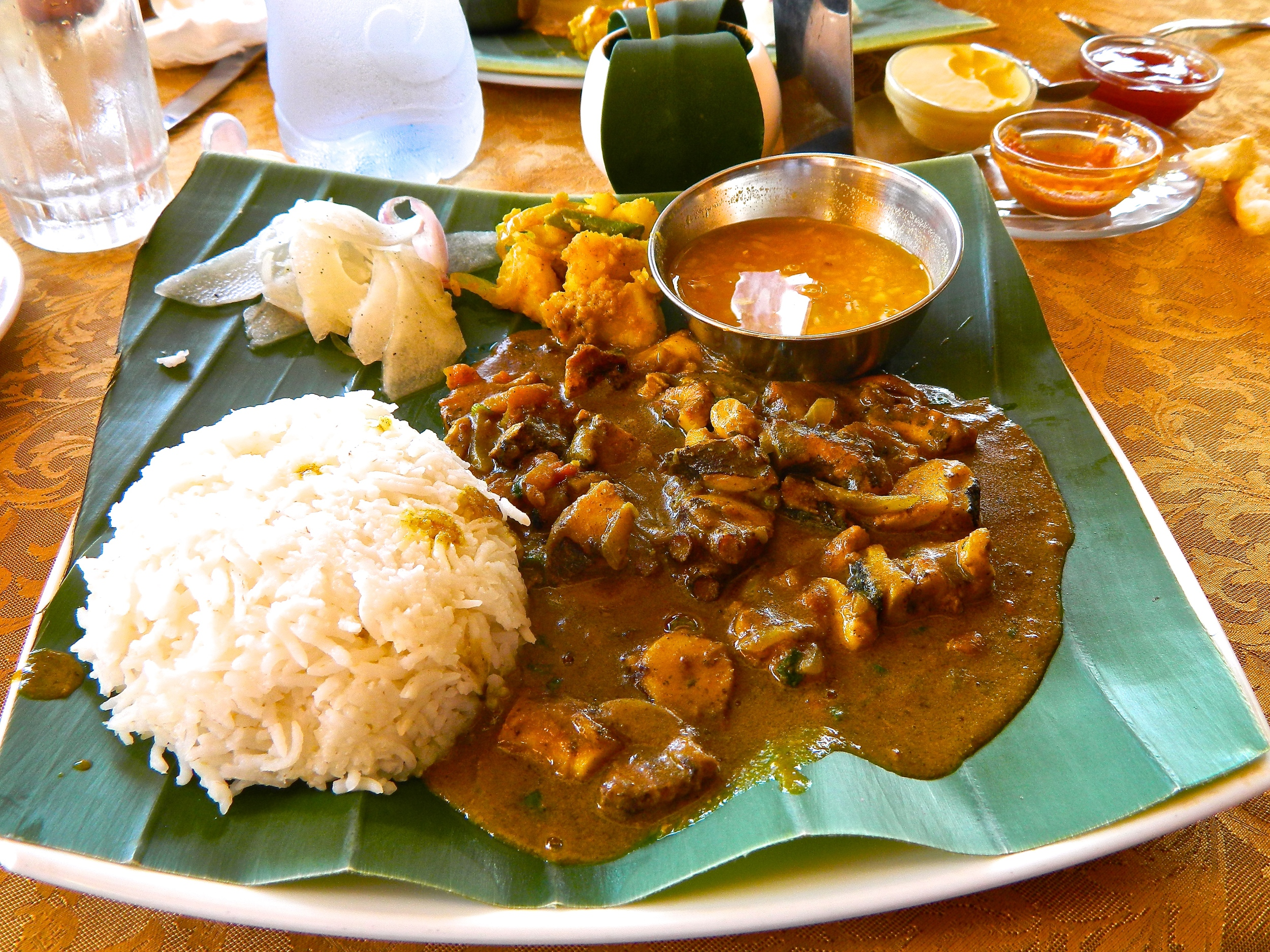 Octopus Curry with steamed rice, daikon salad, curried potatoes and saffron infused onion with chilly dipping sauce.