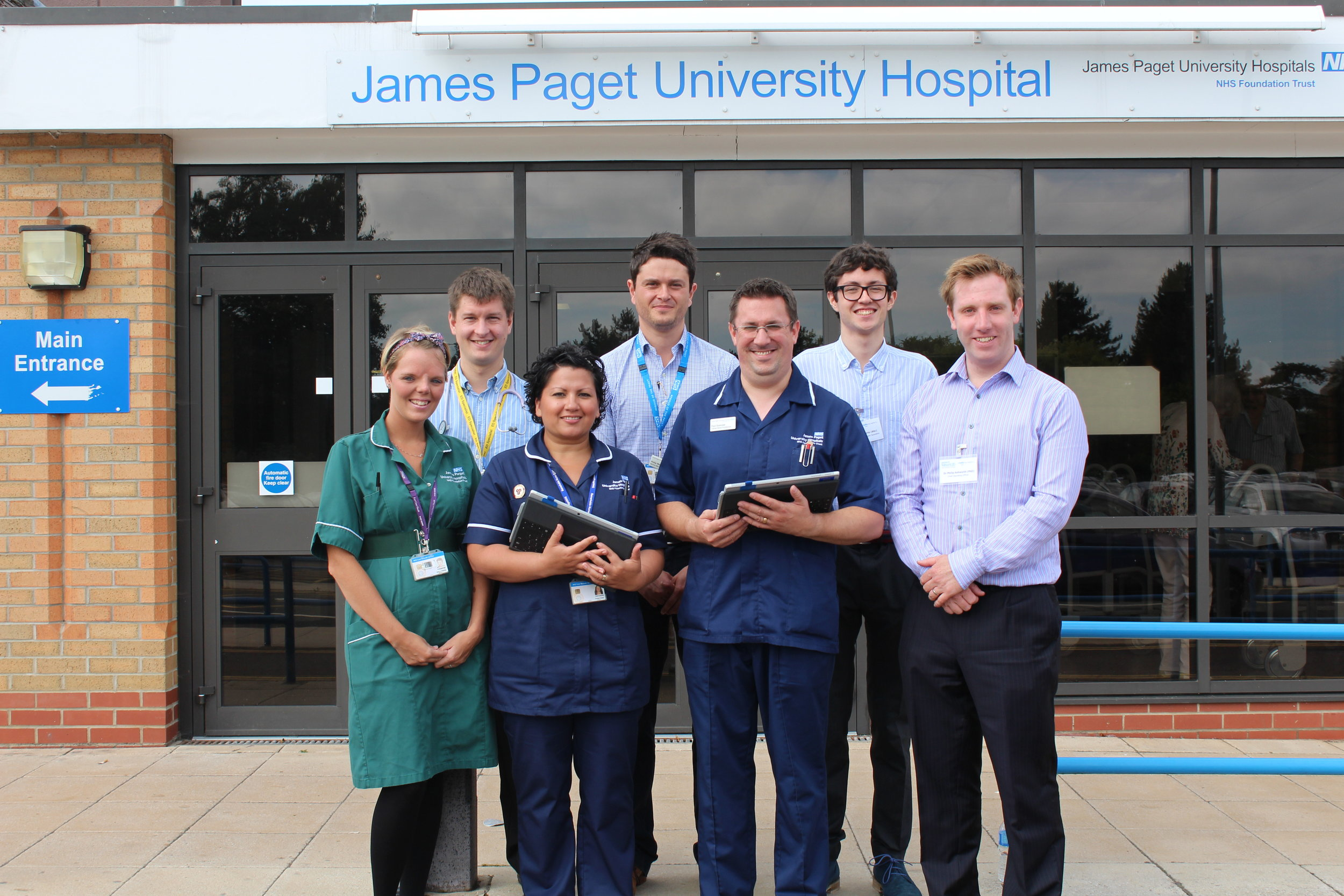 James Paget Hospital Ambulatory Care Unit staff standing with members of the PatientSource team outside of JPUH (Photography by Laura Crisp)