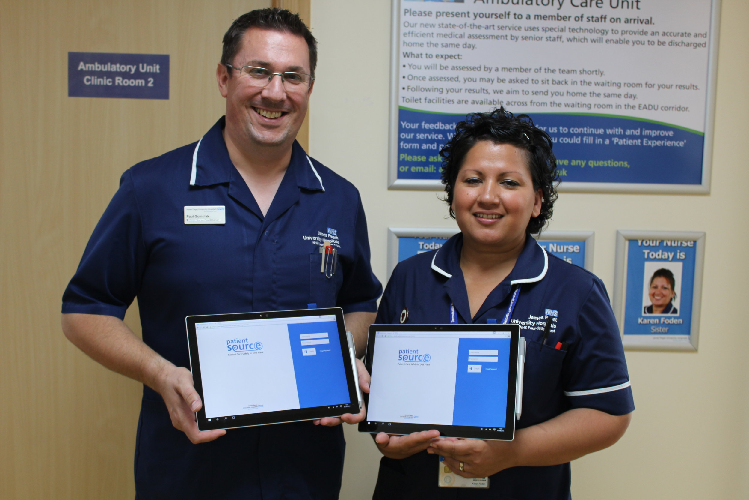 Nurse Practitioners Paul Gomulak and Karen Foden holding the Microsoft Surface 4 Pro tablets which have been loaned to JPUH Ambulatory Care by Microsoft for PatientSource's trial (Photography by Laura Crisp)
