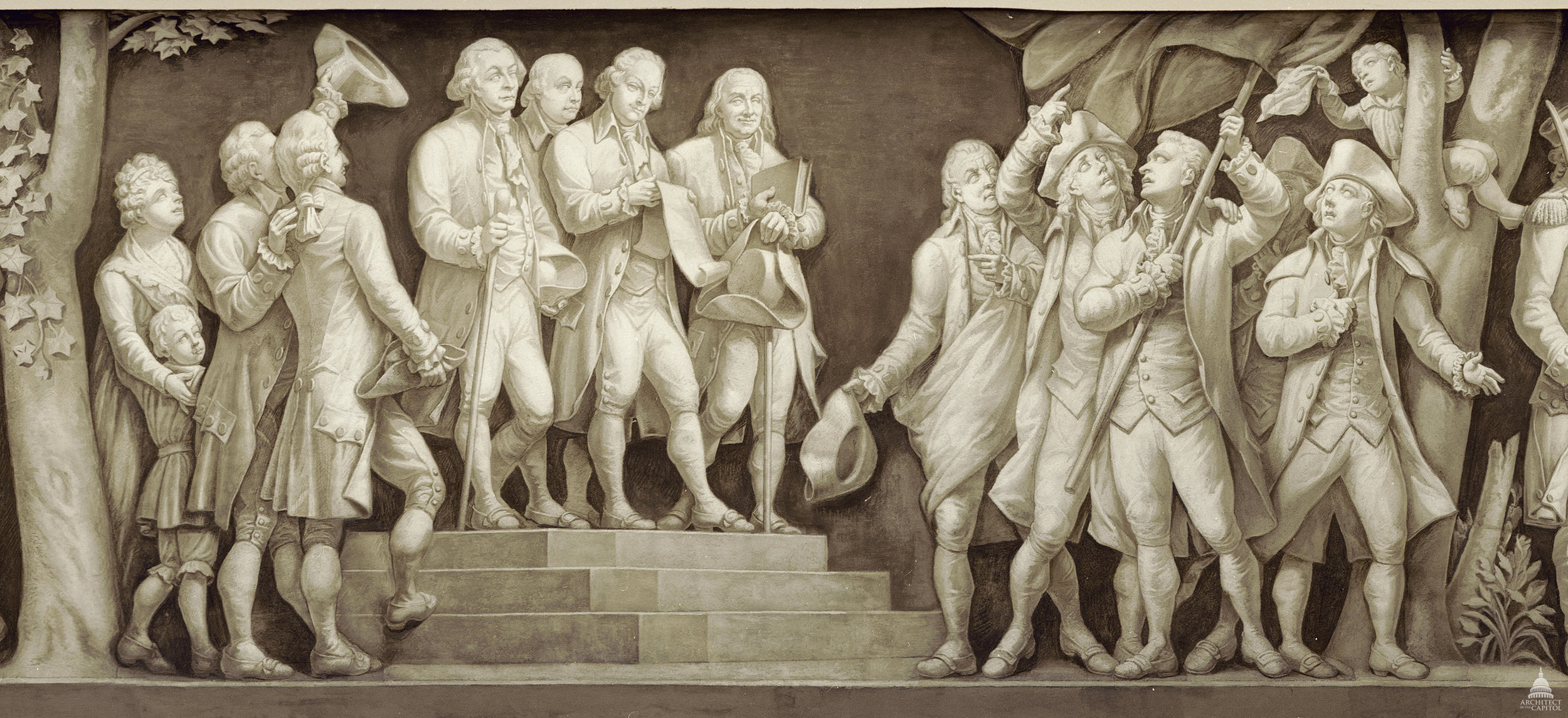 This idealized depiction shows the principal authors of the Declaration of Independence, John Adams, Thomas Jefferson and Benjamin Franklin, reading the document to colonists in 1776. From the frieze of American history in the Rotunda of the U.S. Capitol. Photo by Architect of the Capitol.