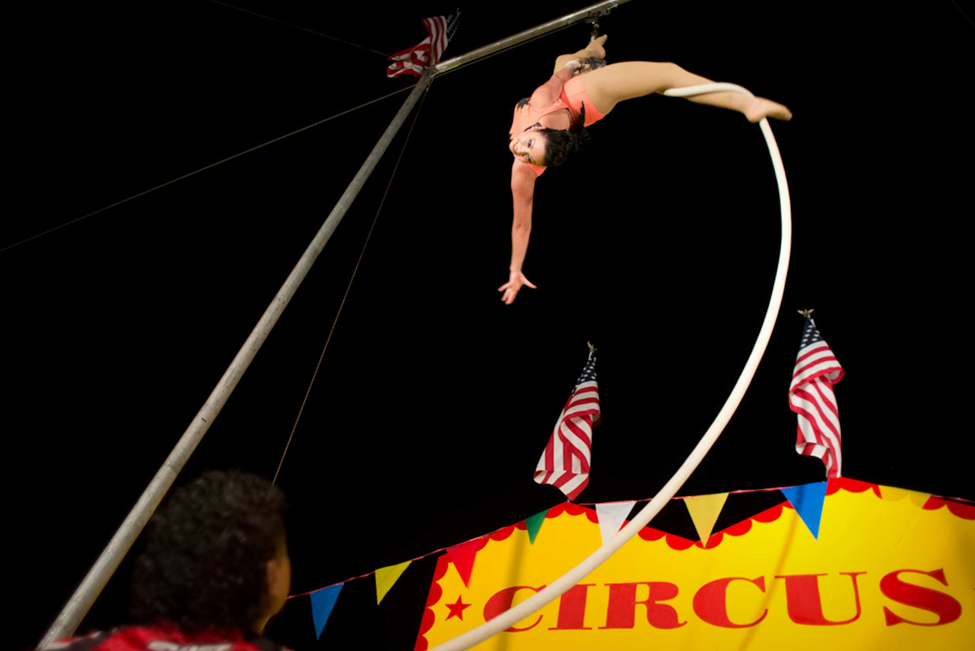 Liza performs aerial ballet during the final show of the night while Oscar controls the rope from below.