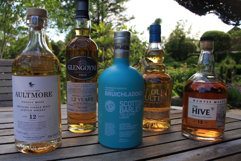 Bottles at the ready for a recent Whiskies in the Garden tasting.