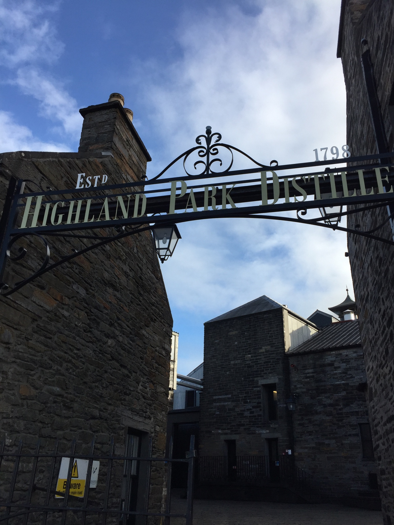 The austere yet landmark entrance to the Distillery - warmed by the blue sky!