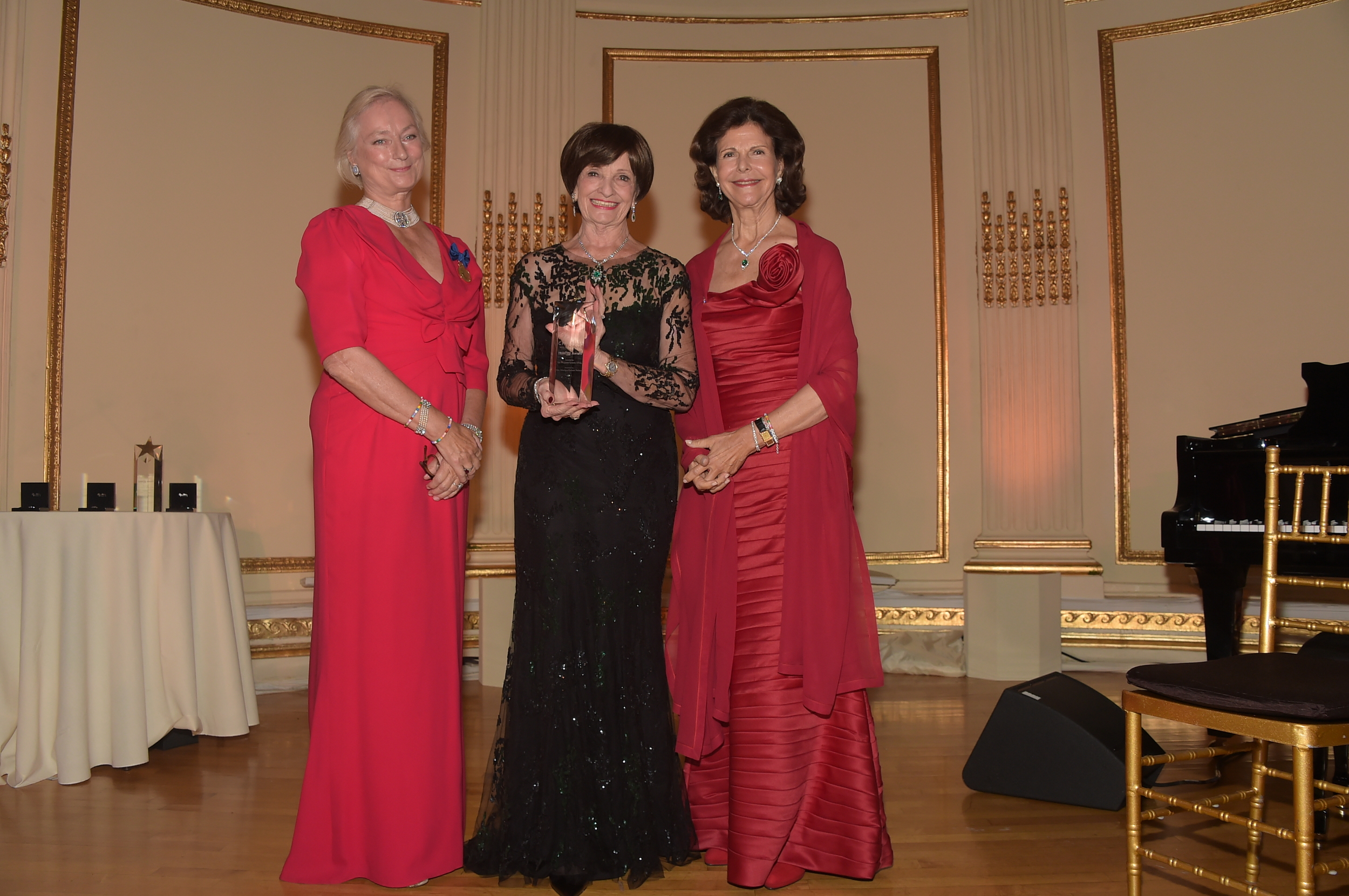 HM Queen Silvia (R) with Marilyn Carlson Nelson (C), Lena Kaplan (L)