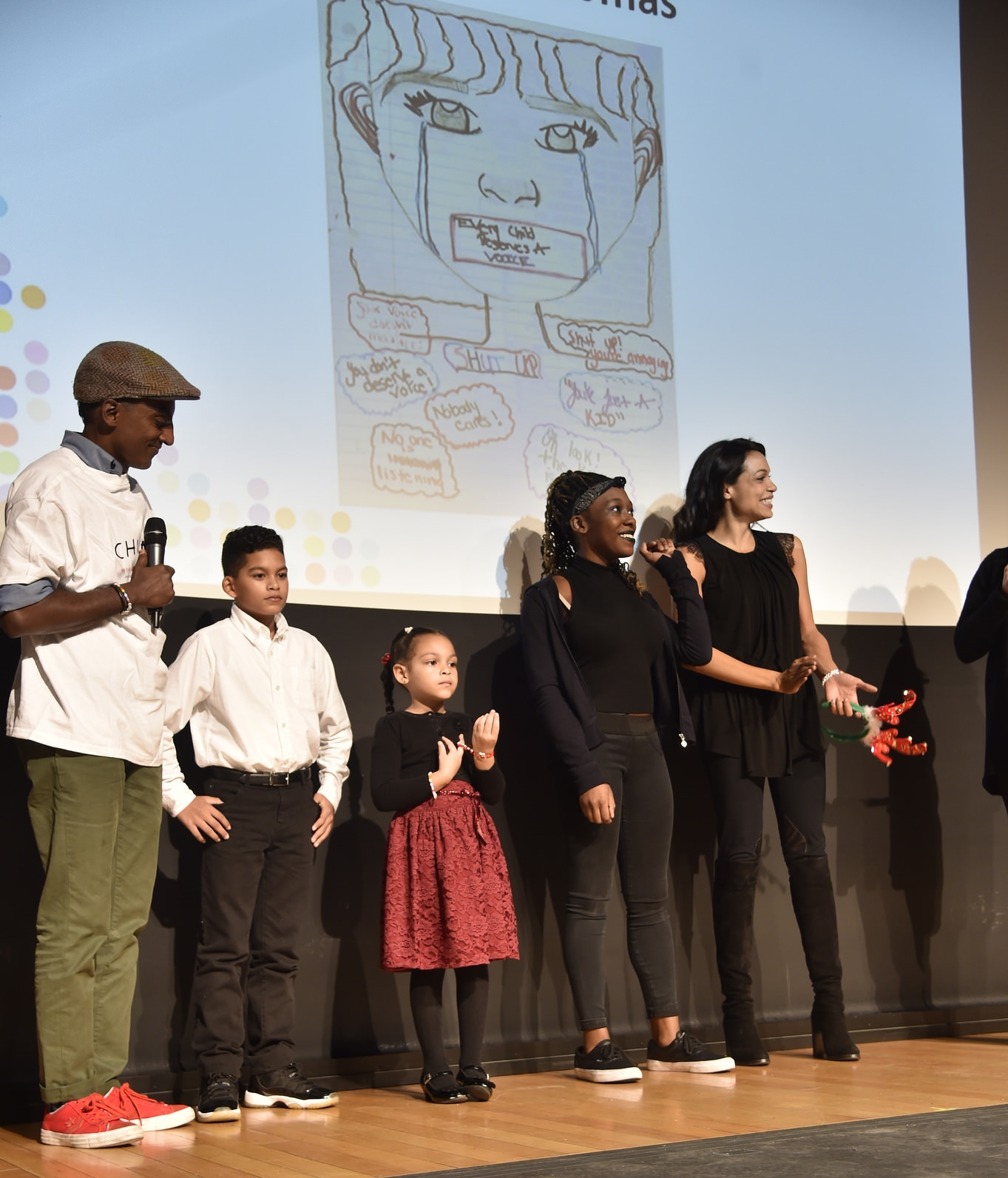 ThankYou Young Artist Award winners with chef Marcus Samuelsson (L) and actress Rosario Dawson (R)