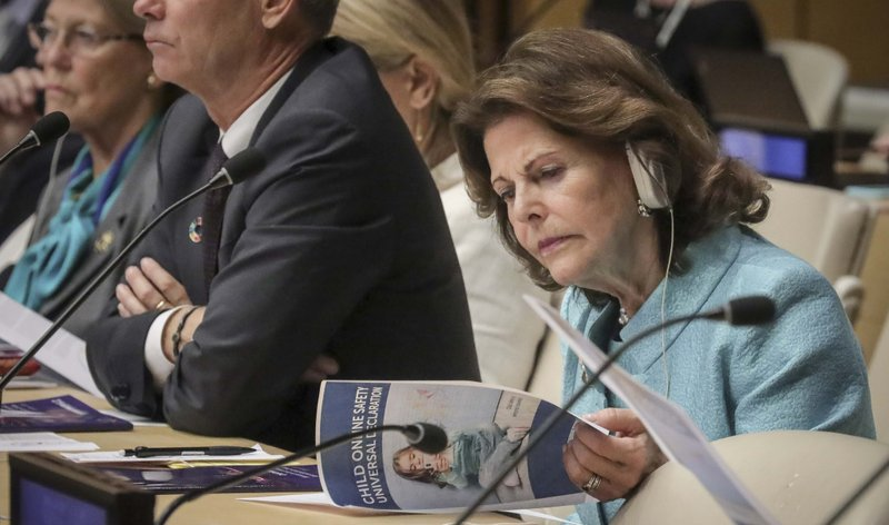 Queen Silvia of Sweden, founder of the World Childhood Foundation, reviews a report on child online safety from the Broadband Commission for Sustainable Development, during a high level meeting at the United Nations, October 1, 2019.
