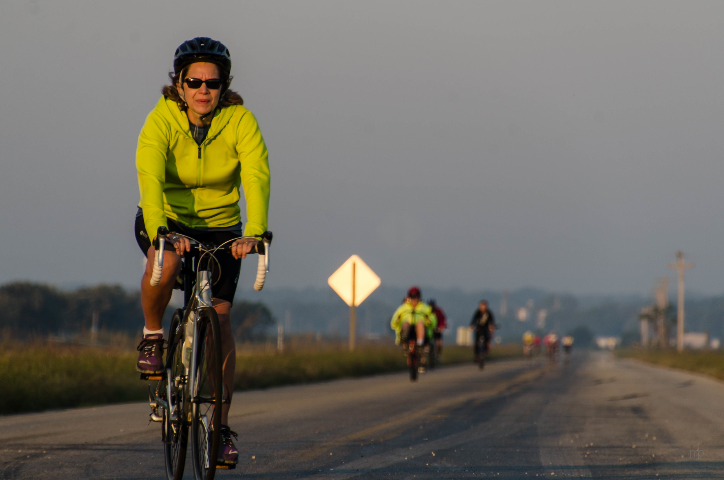 Yellow Brick Road Bike Rider. Nikon D7000, Tamron 18-270, ISO100, 270 mm, f/8.0, 1/160 sec
