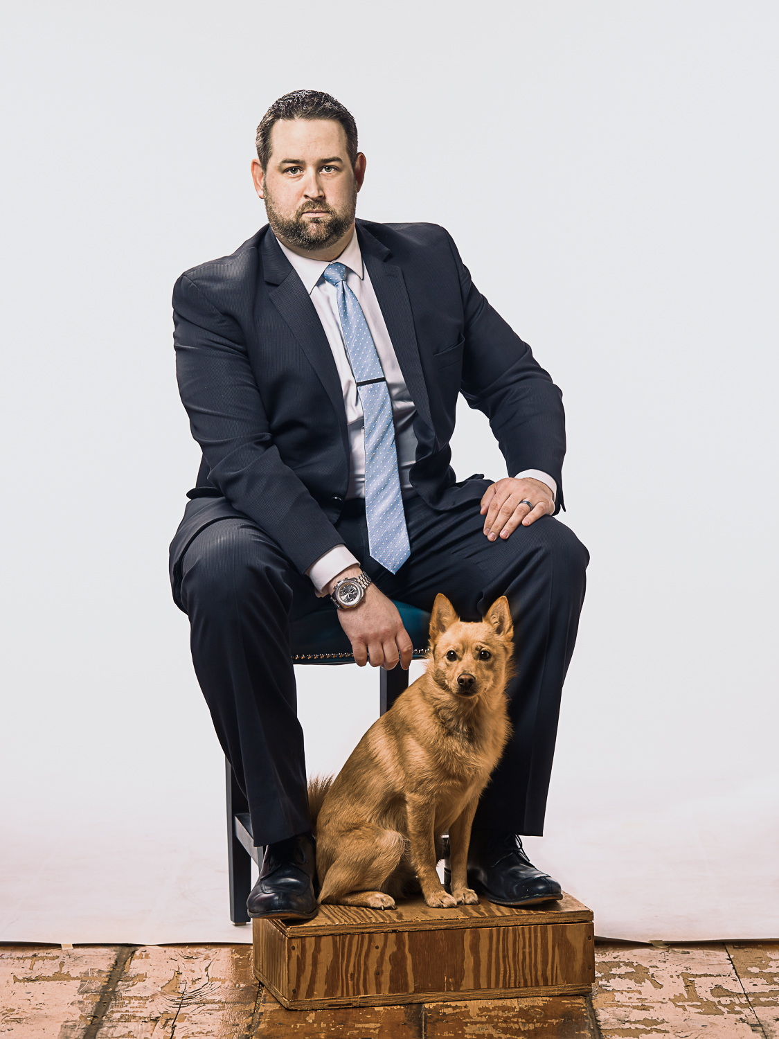 stoic portrait of business man and his dog