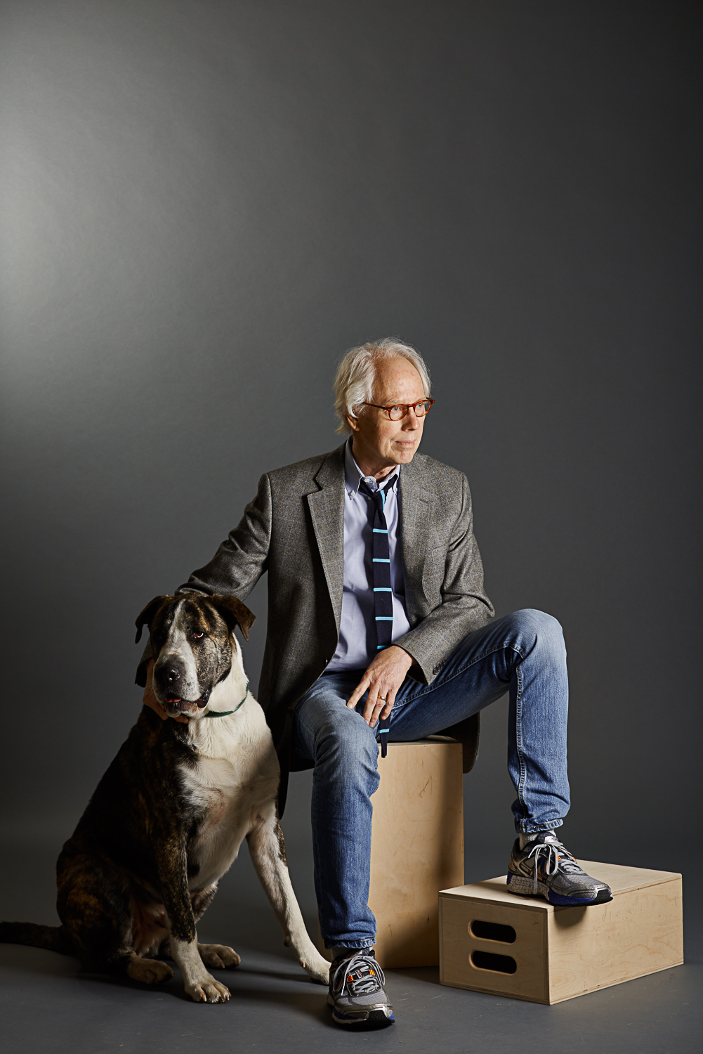 moody portrait of a older man and his dog