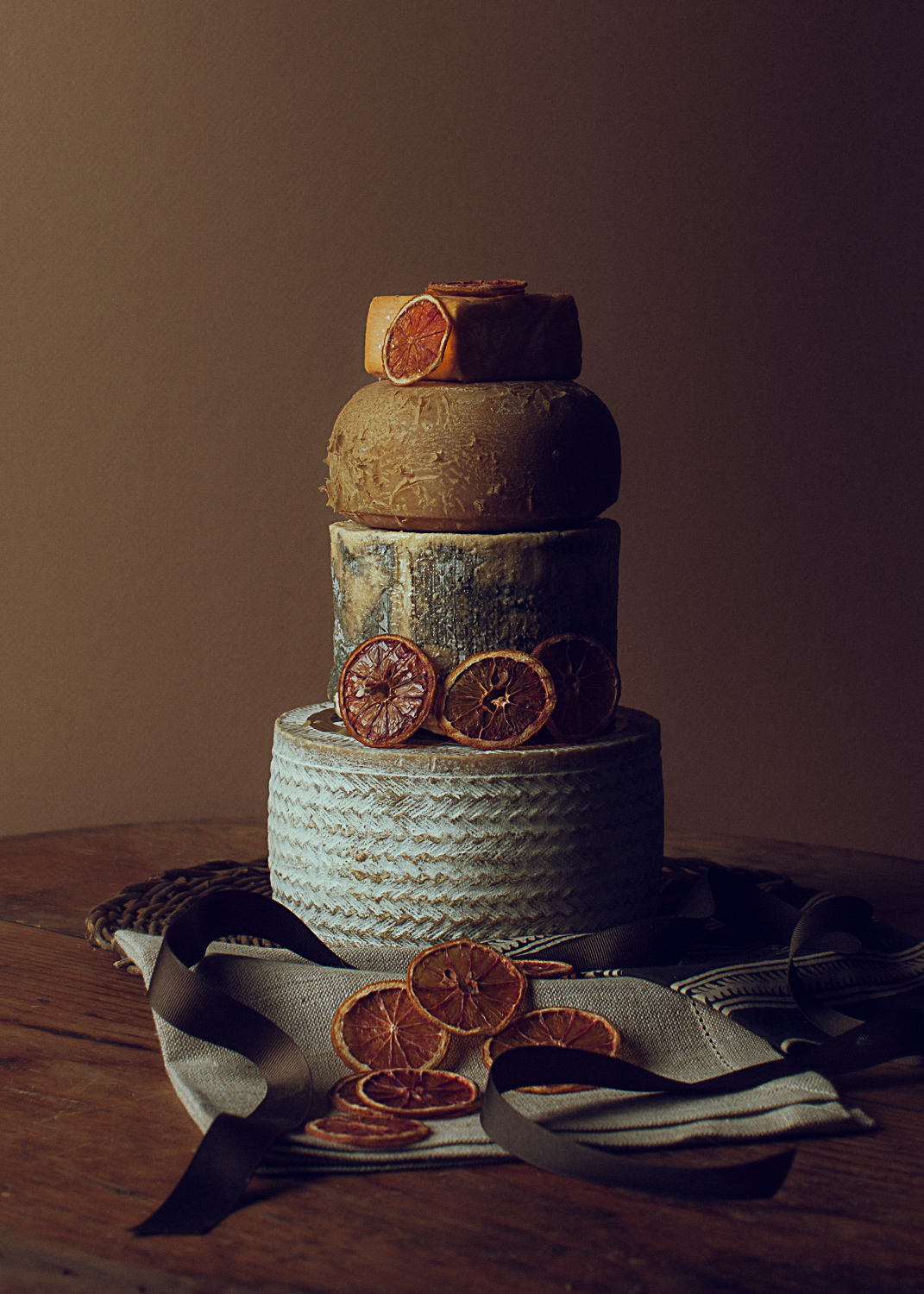 a tower of aged cheeses