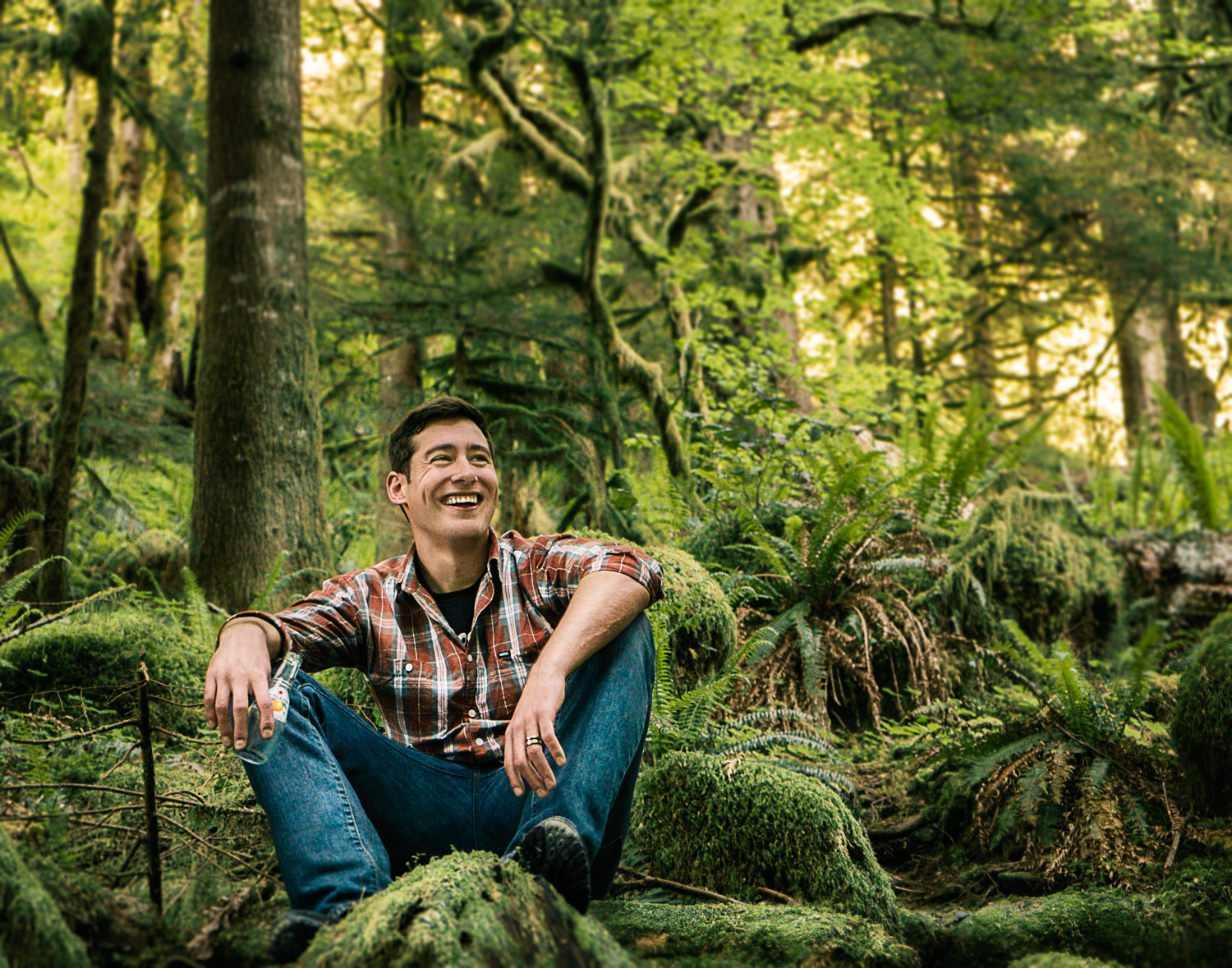 lifestyle portrait of guy sitting in the woods
