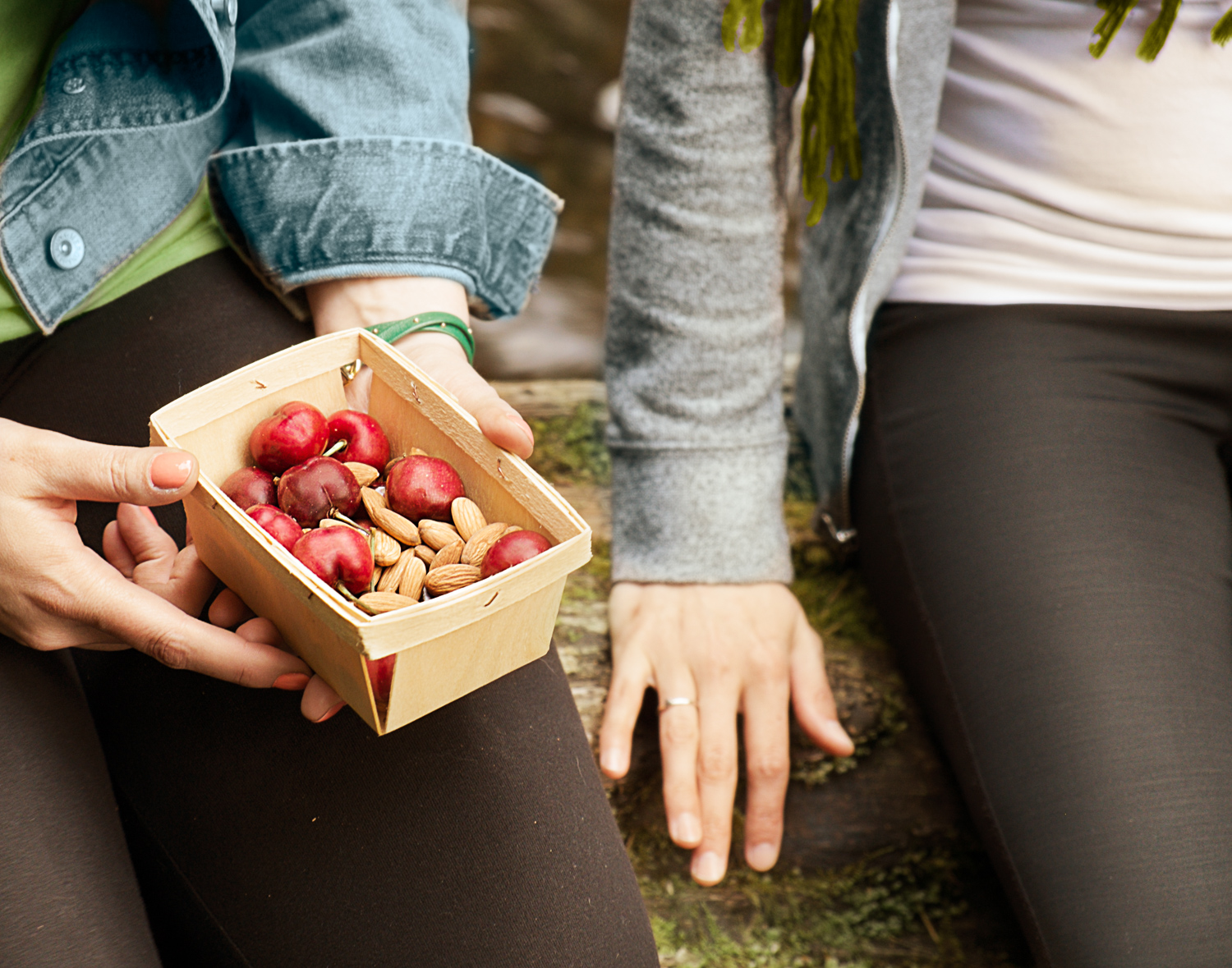 woman holding a box of strawberries