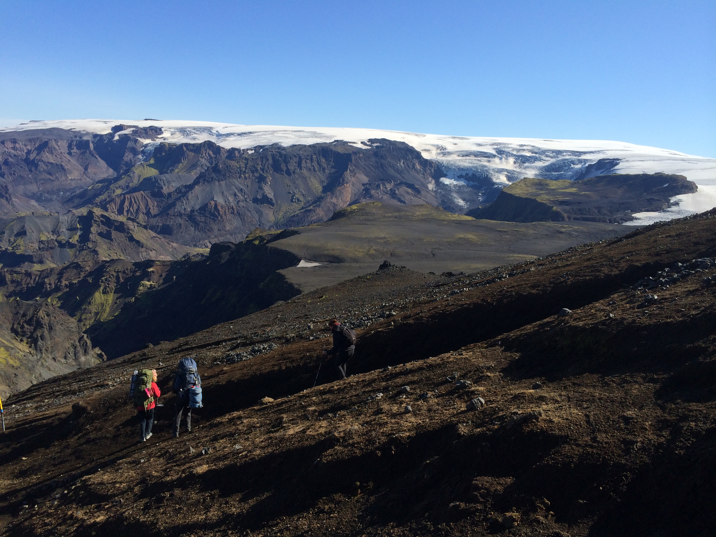 Walk down the mountain and watch the Eyjafjallajökull