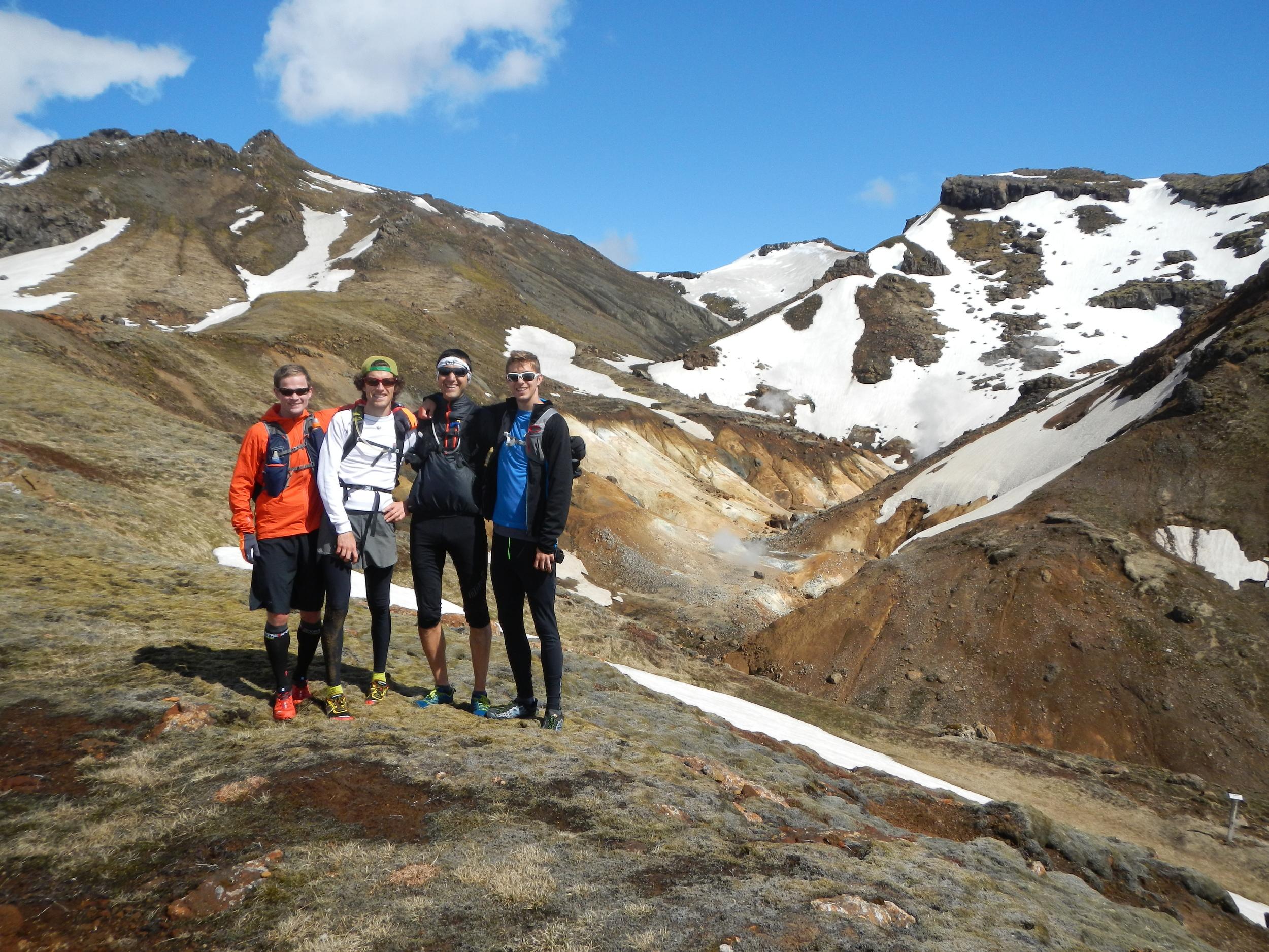Four man standing on a mountain ridge