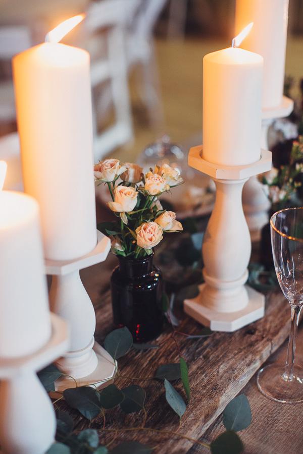 (White pillar candles on barnwood) Maile Lani Photography
