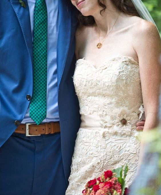 bride lace dress groom blue suit