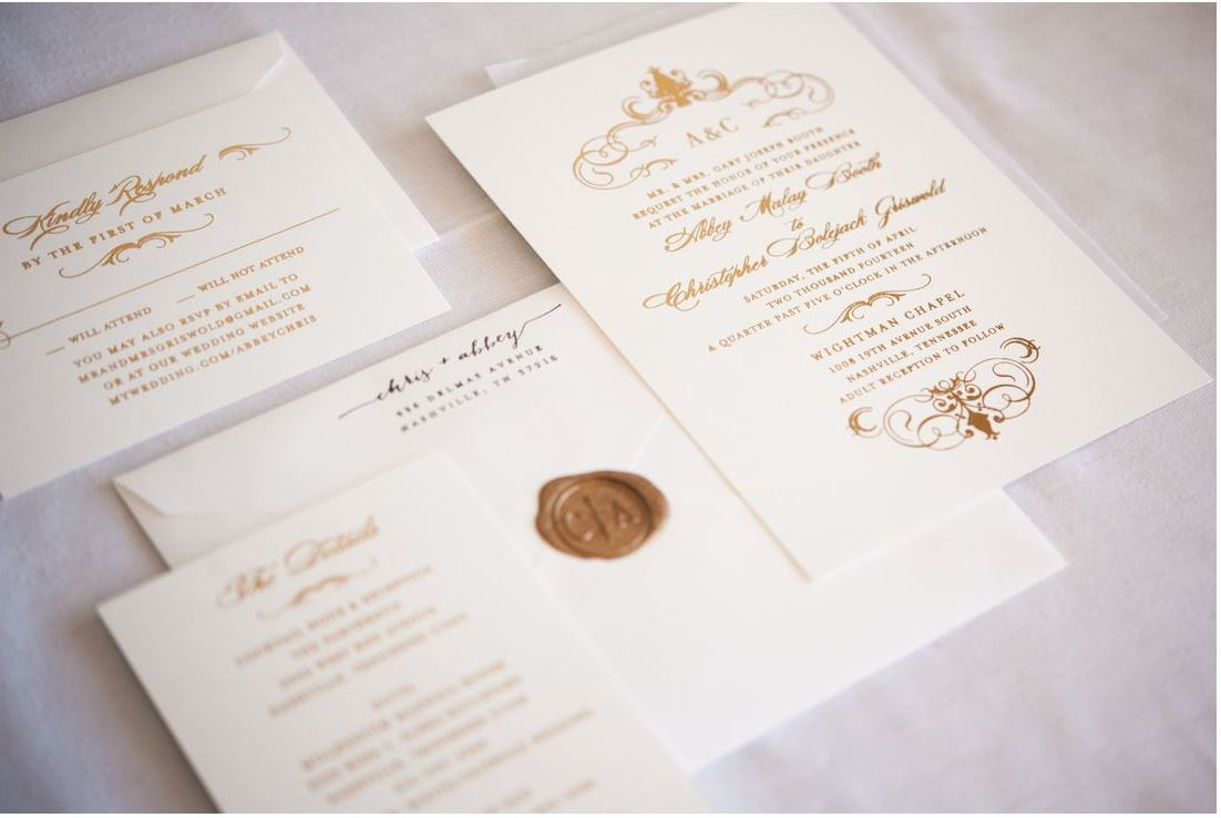white and gold calligraphy invitation suite