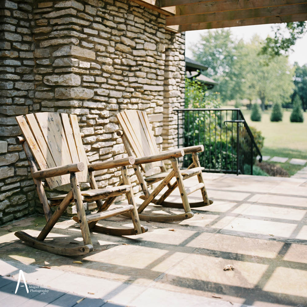 stone cottage wood rocking chairs