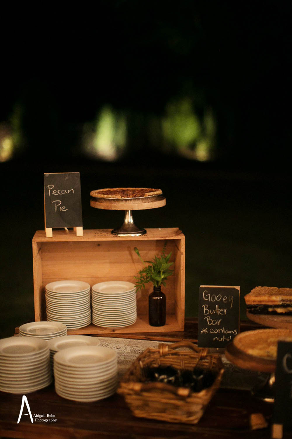 dessert display with crates and pies