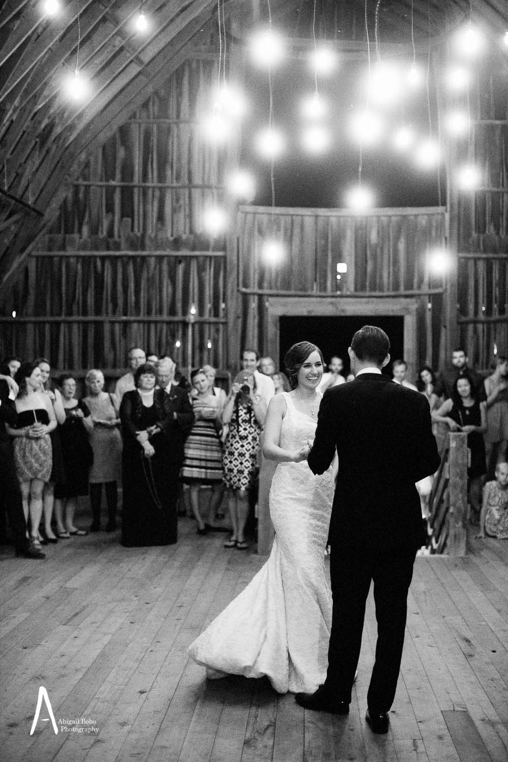 bride and groom dancing in a barn loft