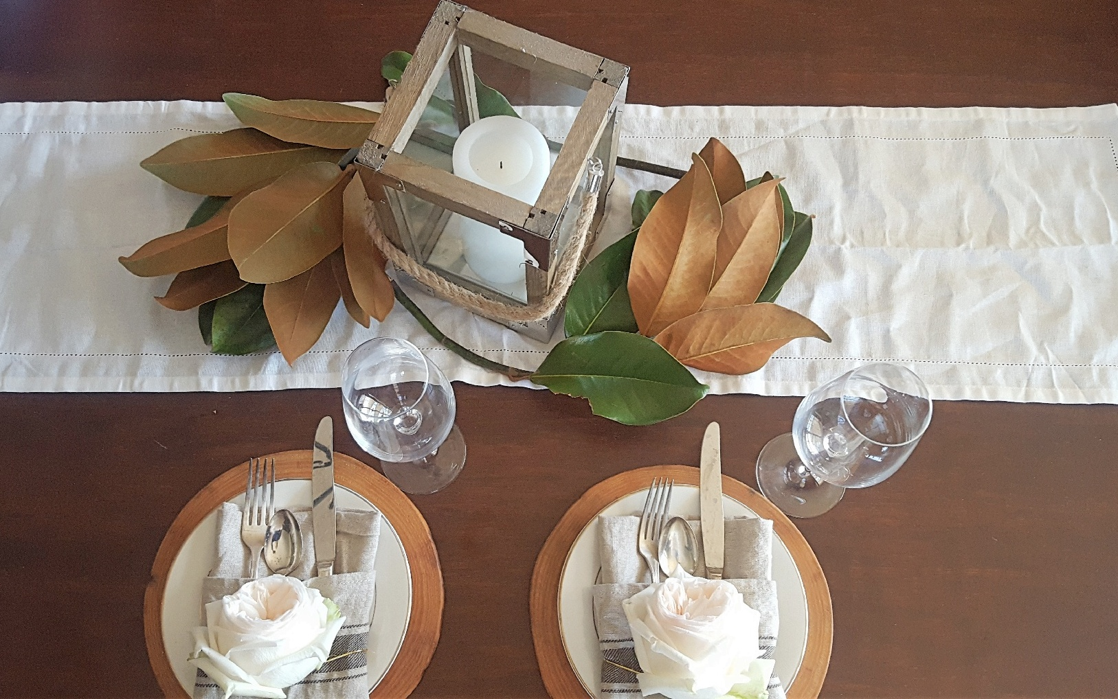 lantern magnolia leaves rose tablescape.jpg