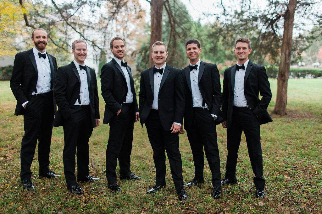 groom and groomsmen in black tuxes