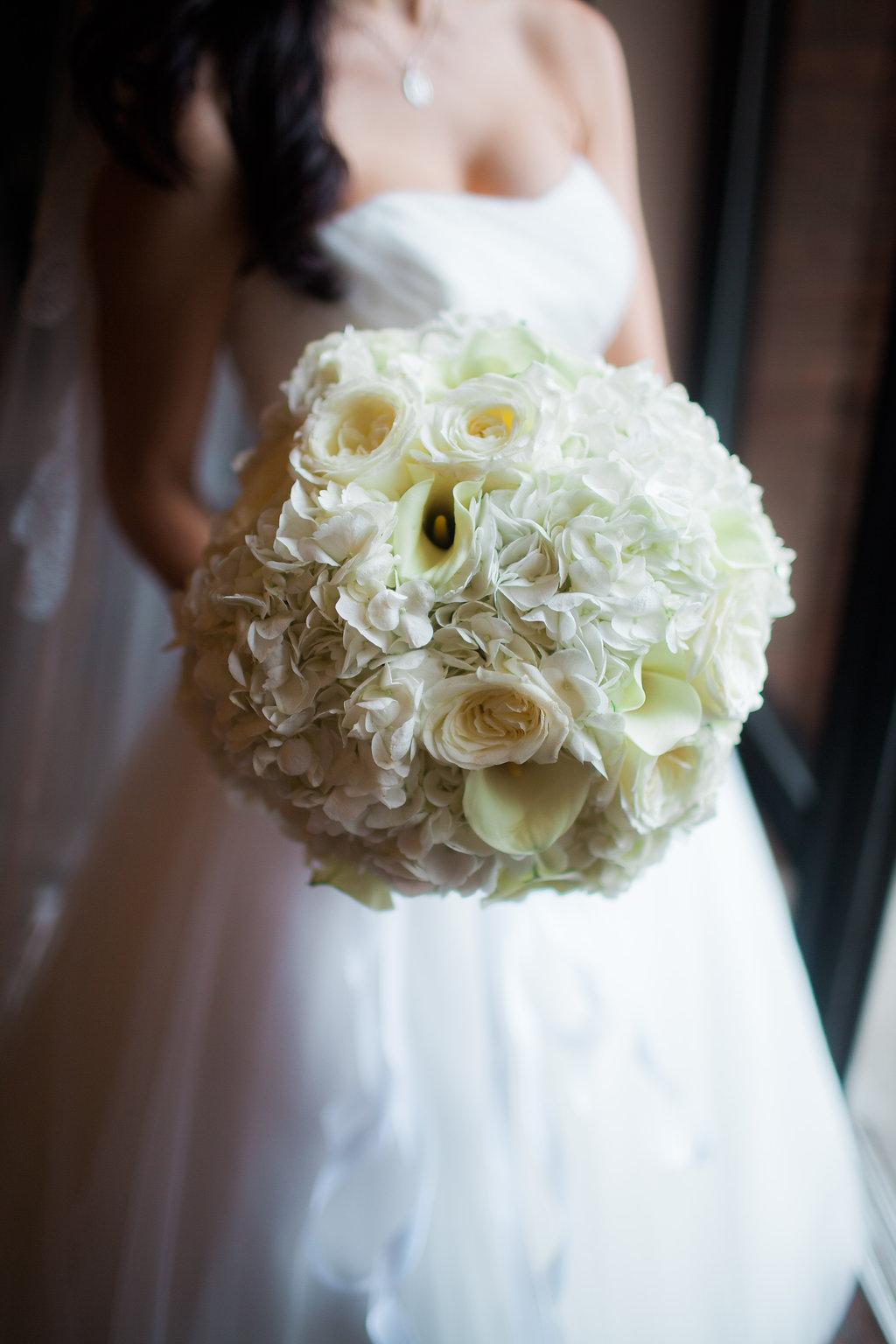 bride holding white bouquet