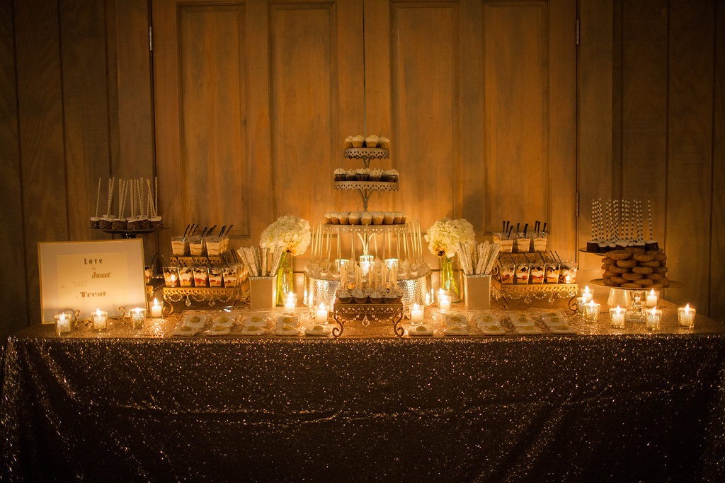 amazing dessert display table gold and candles
