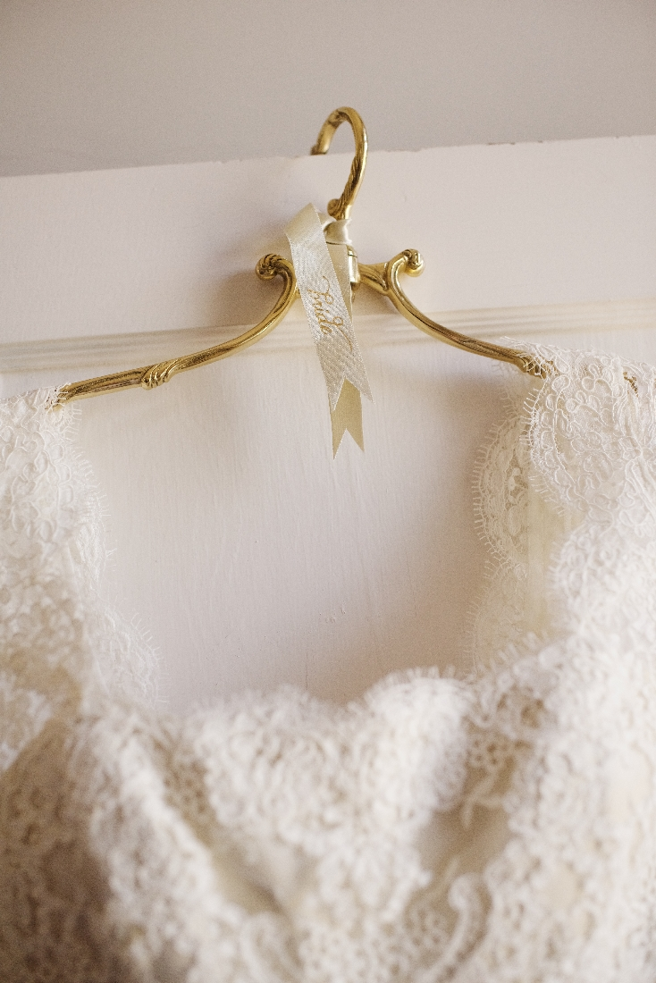 wedding dress on a gold hanger