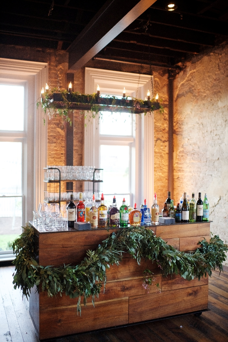 beautiful bar with greenery and lighting.jpeg
