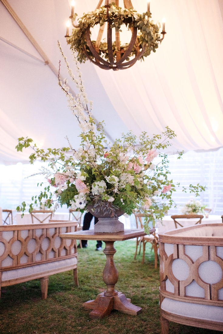 large centerpiece under wooden chandelier.jpeg