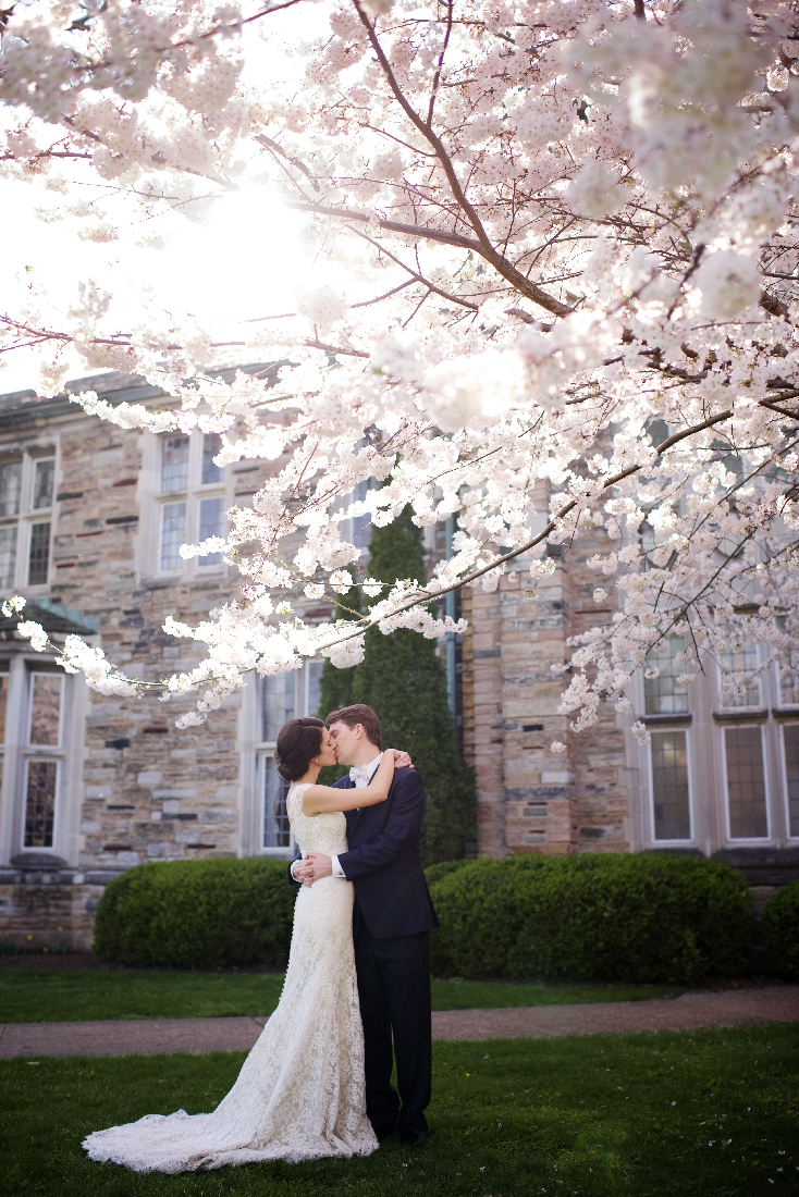 bride and groom kissing springtime.jpeg