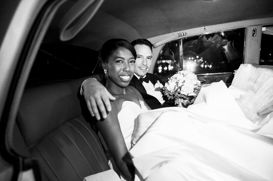 bride and groom in car.jpeg