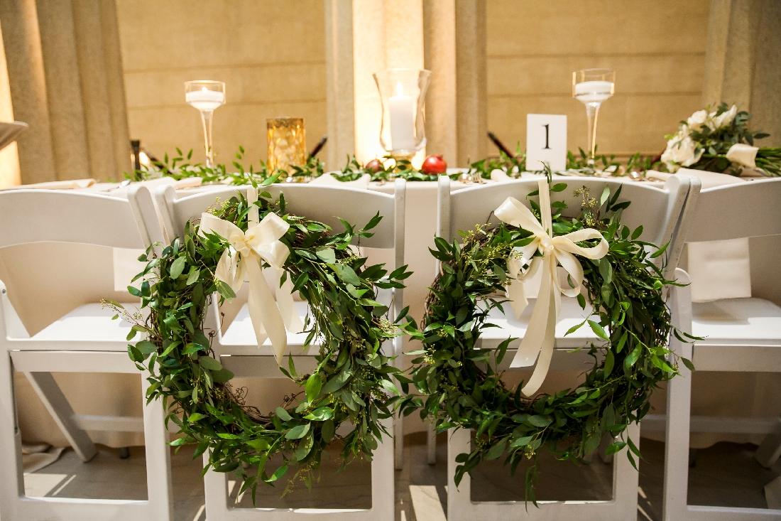 greenery wreath on chairs.jpeg