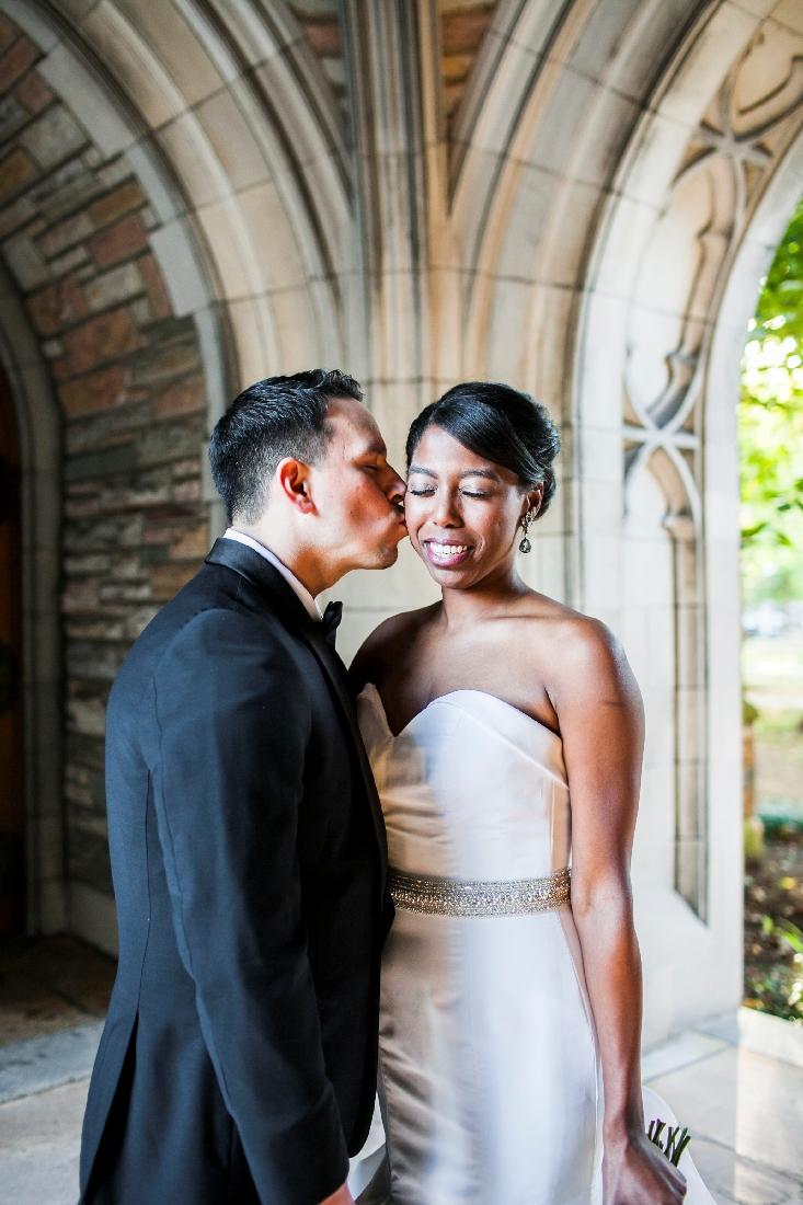 groom kissing brides cheek.jpeg