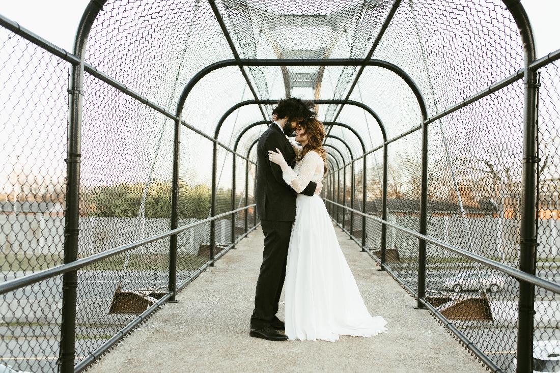 bride and groom on bridge.jpeg
