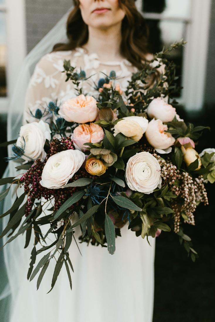 bride holding large bouquet.jpeg